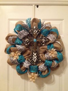 Cross on Burlap wreath, with turquoise and zebra accents.