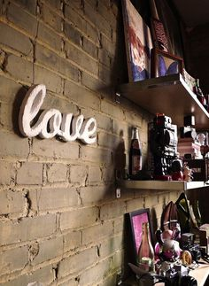 """Spread the love with this wooden """"Love"""" sign ($38) cut from reclaimed wood."""