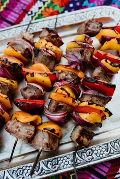 These steak fajita skewers are so simple to make and perfect for upcoming holidays like Memorial weekend and Father's Day which are fast approaching. Sizzling fajitas on a stick! Steak Fajita Skewers are perfect for summer grilling - tender pieces of steak, colorful bell peppers, and bright red onion grilled to perfection. Healthy grilling never looked so good! #steak #fajitaskewers #barbecue #grilling #Mexican | MuyBuenoCookbook.com @MuyBueno