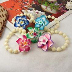 Pulsera perlas con flores