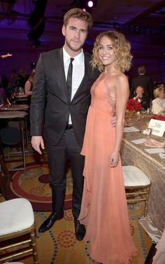 Miley Cyrus in a pink dress with Liam