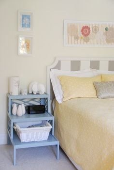 Homemade doilies framed above bed  side table