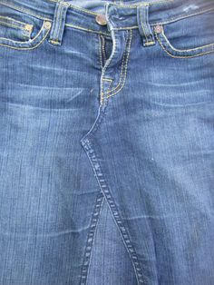 How to turn a pair of trousers into askirt. Nice tutorial pictures.