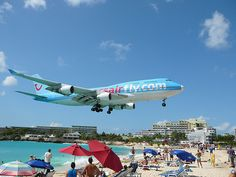 Vacation in St. Maarten (Maho Beach) to watch planes land.