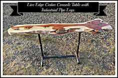 Live edge cedar console table with pipe legs. Follow us for more wonderful pins at www.pinterest.com/3spurzdandc www.facebook.com/3SpurzDesignsAndCollectables