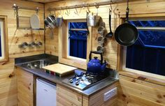 The ground floor has a bathroom and decent-sized kitchen that is full of smart storage space. - Tiny Abode via Facebook