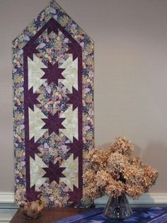 """Hunter's Star Pointed Table Runner, The first of Deb's designs using the Rapid Fire Hunter's Star tool and technique. The project uses just 3 fabrics and can be made in a single sewing session - couple of hours if you're fast. Suggested size is for 6"""" blocks, but it could also work with the 5"""" or 7"""" block options."""
