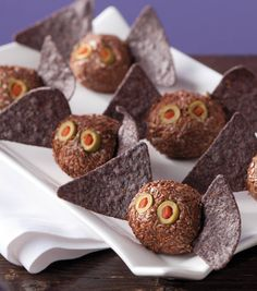 Mini bat cheese balls with tortilla chip wings make fun Halloween party food!