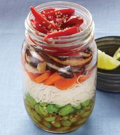 Layers of colorful veggies and brown rice noodles make for a healthy lunch that is easy to transport.