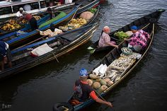 Early Trading at Floating Market. @ Kuin Floating Market, Banjarmasin.  Trading starts as early as 5am. Barter system still implemented these days. It is a spectacular sights..