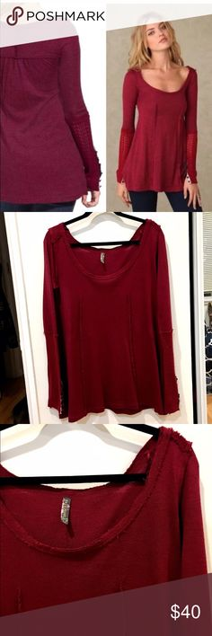 """Free People Raw Sean sweater tunic Tunic style sweater from FP. Berry red color. Floral appliqué button cuffs. Scoop neck and ruching at the back. Reverse seams. Acrylic/rayon/wool. Unfinished/raw seam bateau neckline. Length from shoulder is 29"""". Armpit to armpit flat is 19"""". Stretchy. Gently worn. Light pilling due to fabric content. Small, professionally repaired snag on left arm, as shown in 4th pic. Priced accordingly. Free People Sweaters Crew & Scoop Necks"""