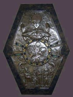 This medallion was found inside an ancient Egyptian tomb. If you look closely you'll notice that the heads of the Pharaohs are elongated. You will also notice that the head at the very top resembles the head of an ALIEN GREY, and that there's also a disc-shaped UFO right below it.