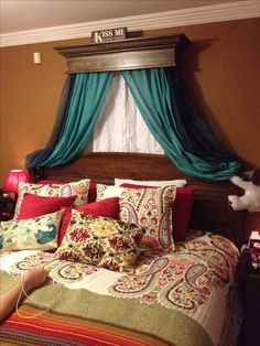 I love the shelf over the bed with curtains! I may have to do this!