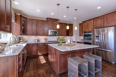 #modelhome #browncabinets #modelhome #kitchen #granite #islandcounter