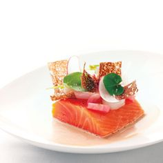 Danny Grant's wild king salmon, pumpernickel, radish, caraway.  Photo by Anthony Tahlier