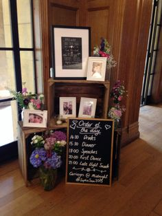 Styling with wooden crates & family photographs at Coombe Lodge to welcome guests to the reception. Www.littleweddinghelper.co.ik
