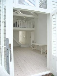 Something very serene about a white studio, or white everything with hints of sea blue!!