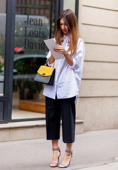 An embellished button-down blouse is worn with cropped culottes, a printed satchel, and ankle-strap heels