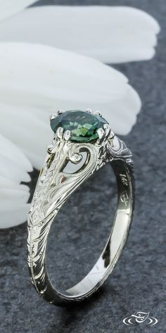 A Montana Sapphire twist on a classic Antique style engagement ring. Green Lake Jewelry