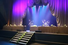 head table on the stage...so cool for a theater reception