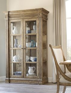 Touch hinge LED lighting, glass doors, and wood frame glass shelves make this curio china a perfect storage piece for accents.