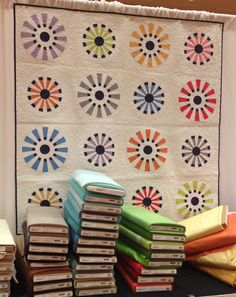 """circle quilts :: I like the """"sunburst"""" radiant pattern with the dots alternately at the center and tips of the rays."""