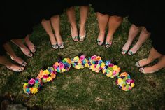 Fun photo to show off the bridesmaids' shoes and flowers