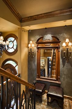 Great combination of color tones, window over the door, wood, faux painting on walls and trim, balusters, and lighting.