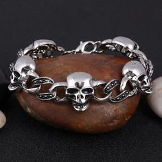 Add instant style to any casual look with this chunky skull bracelet. The Stainless Steel Chain Link Skull Bracelet is made from durable stainless steel and features a unique design with twisted chain