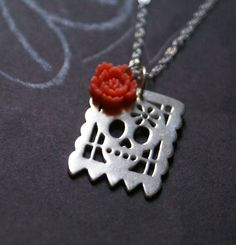 One Little Skull Papel Picado necklace in sterling silver. Lauren Mojica, via Etsy.