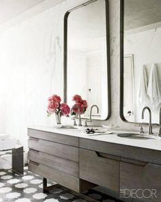 A Revived Townhouse in London   Bathroom - Carrara Marble slab walls and vanity with undermount sink, Gunmetal Mirrors, dornbracht fixtures Morrocan tile floors, driftwood cabinetry by Steven Volpe Design