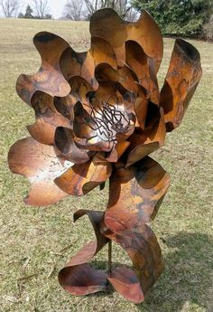 Hey, I found this really awesome Etsy listing at https://www.etsy.com/listing/185432704/original-welded-metal-art-flower-garden