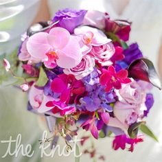 Beautiful bouquet filled with a variation of orchids, roses and lilies.