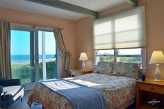 The bright downstairs double bedroom looks out on the water. Dennis, Cape Cod vacation rental on WeNeedaVacation.com ID 7745