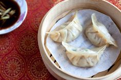 Steamed Dumplings - use a cabbage lined metal steamer if a bamboo steamer is not available. Make ahead of time, freeze on cookie sheet, place in container for easy quick steamed appetizers later.
