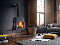 6 Modern Takes On Wood Burning Stoves Architectural Digest Modern Gas Stove Fireplace Modern Freestanding Gas Stove Fireplace Gas Stove Fireplace, Wood Fireplace, Modern Fireplace, Fireplaces, Pellet Stove, Modern Wood Burning Stoves, Wood Burning Fires, Wood Stoves, Paint Your House