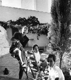 Spanish artist Salvador Dali (1904–1989) with his wife Gala (1894–1982) and a child at his villa at Port Lligat, 1951. (Photo by Daniel Farson)