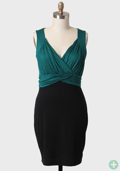 Enchanted Evening Curvy Plus Dress In Teal  36.99 at shopruche.com. This elegant black and teal dress features a gathered surplice neckline, a ruched waist, and lots of stretch for a flattering fit. Finished with a sleek skirt, this dress looks great with simple jewelry and a pair of black...