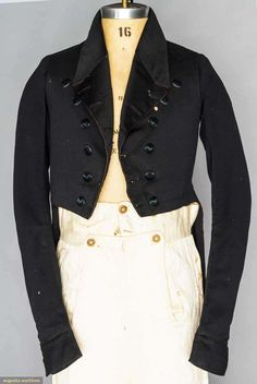 BLACK WOOL TAIL COAT, AMERICAN, c. 1840 Broadcloth, rever collar & lapels finely hand quilted, double breasted & may be worn left over right or visa-versa, black silk buttons embroidered w/ single black thistle, narrow inset W band, homespun red wool batting, outer tail pockets, 1 hidden inner pocket, (moth holes, tears & wear) very good. James Kochan - Don Troiani Collections - Augusta Auctions