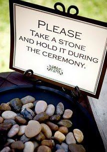 Blessing/Oathing Stones. When the Bride & Groom exchange their vows each guest will hold a stone in their hand and take that moment to reflect on all the well wishes, and happy thoughts they want for the new couple. When the guests exit the seating area they can leave the stones in a basket or decorative vase.   100 Stones. $65.00, via Etsy.
