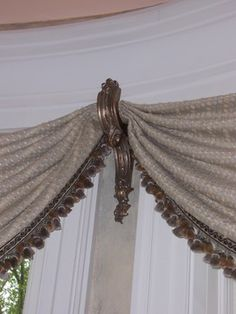 Great idea for hanging the valences in the bay windows in our parlor.