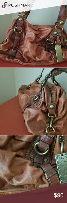 Steve Madden slouch bag Steve Madden slouched bag with hang tag attached. Two handles, zippered pocket and two ruffle edge pockets inside  Beautiful bag never used, in rust color. Steve Madden Bags Hobos
