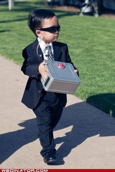 A security themed ring bearer... would be even cuter with a little briefcase