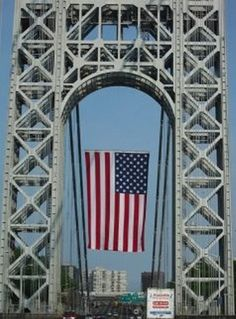 "World's largest free-flying flag hanging from the beautiful George Washington Bridge that connects New Jersey to New York ♥ Like Bruce sings in Jersey Girl: ""Cross the river, to the Jersey side..."" :) ♥"