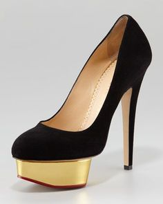 Charlotte Olympia Dolly Island Platform Pump, Black  This gilded-platform Charlotte Olympia pump speaks to the personal style of the up-and-coming London designer-slash-it-girl, Charlotte Olympia Dellal—classic meets fun. The heel makes you almost half a foot taller, but the platform makes the heel's pitch lower (and more comfortable).