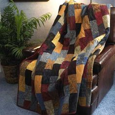 """Flannel Brick Road  Quilt by Love of Quilting staff.  Size: 72"""" x 84    Our staff designed and made this simple, cozy, masculine quilt because we know you probably need a gift for the special guy in your life. Set aside a stack of fat quarters and a weekend and you'll be able to delight him on Christmas morning or his next birthday."""