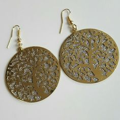 """Tree of Life large Earrings These lovely haning earrings have 14k gold hooks and are attached to two large circles. One is silver sparkling  glitter and over that is a gold tree with leaves. Little over 1 1/2"""" across the circles. Brand new and unused. great with your favorite shirt and jeans. Jewelry Earrings"""