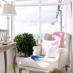 Conservatory and armchair with a view