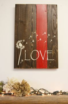 Cute wall decor for Valentines Day or any other time! This is a wood pallet that measures 13 x 20. The wood is stained Espresso and one plank is