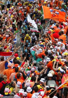 2013 tour-de-france photos stage-18 on Alpe d'Huez  SKY team struggling through the crowds